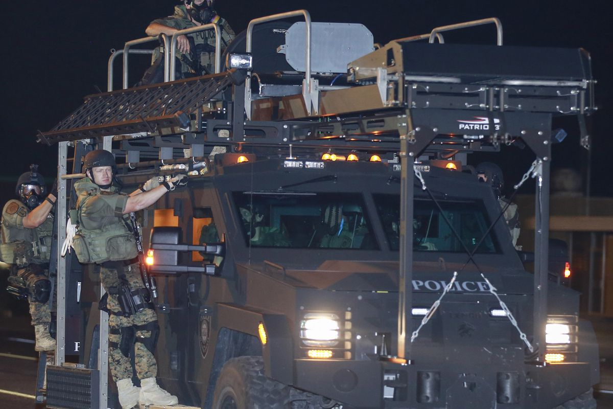 Police using a military-style vehicle in Ferguson, MO.