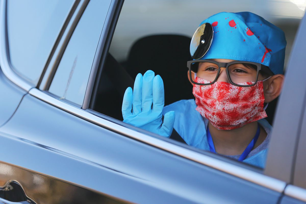 A costumed student during a Halloween drive-thru parade in Salt Lake City on Friday, Oct. 30, 2020.