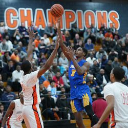 Simeon's Antonio Reeves (3) puts up a shot in the paint against Young, Wednesday 02-13-19. Worsom Robinson/For the Sun-Times.