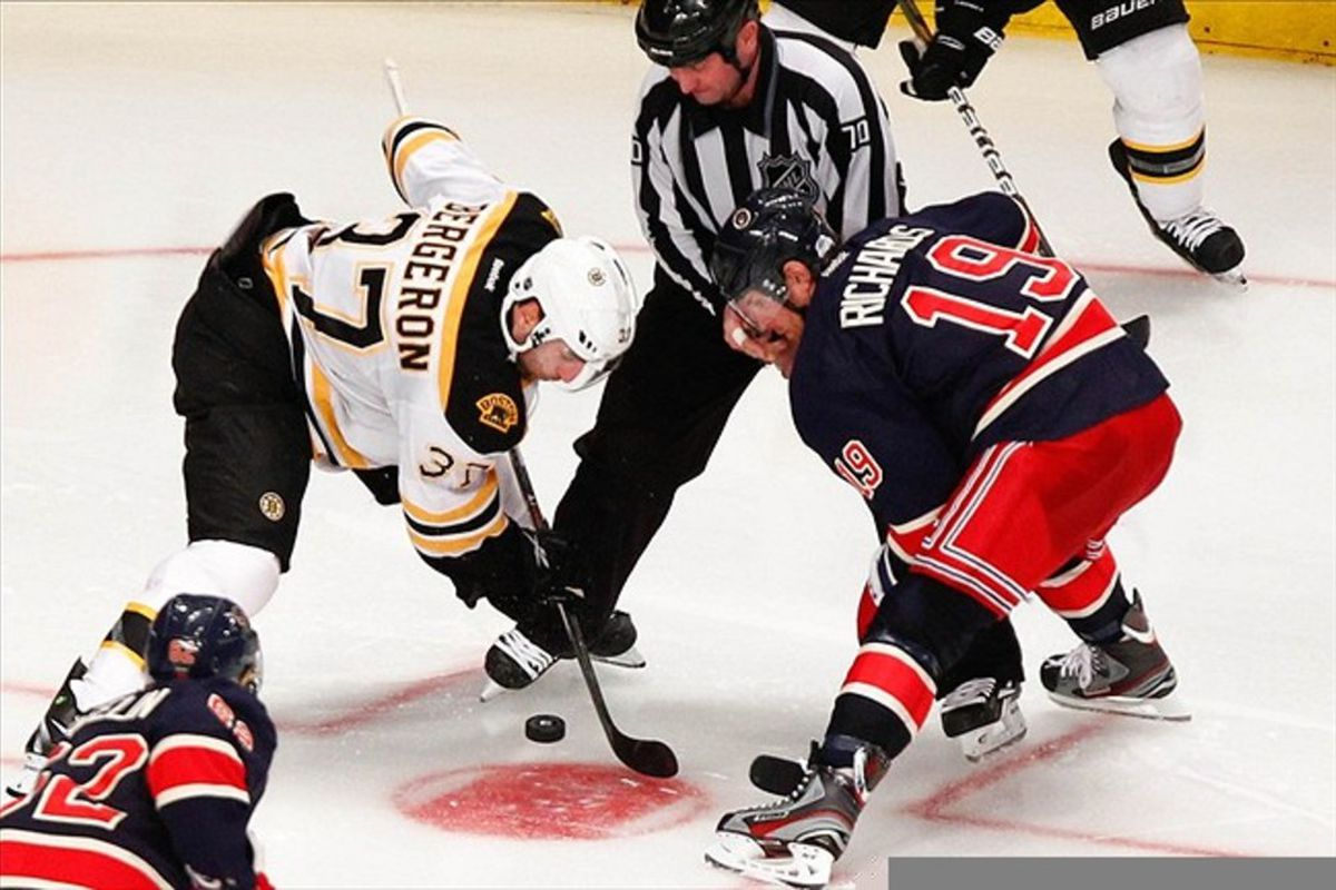 Mar. 4, 2012; New York, NY, USA; New York Rangers center Brad Richards (19) and Boston Bruins center Patrice Bergeron (37) face off during the third period at Madison Square Garden. Rangers won 4-3. Mandatory Credit: Debby Wong-US PRESSWIRE