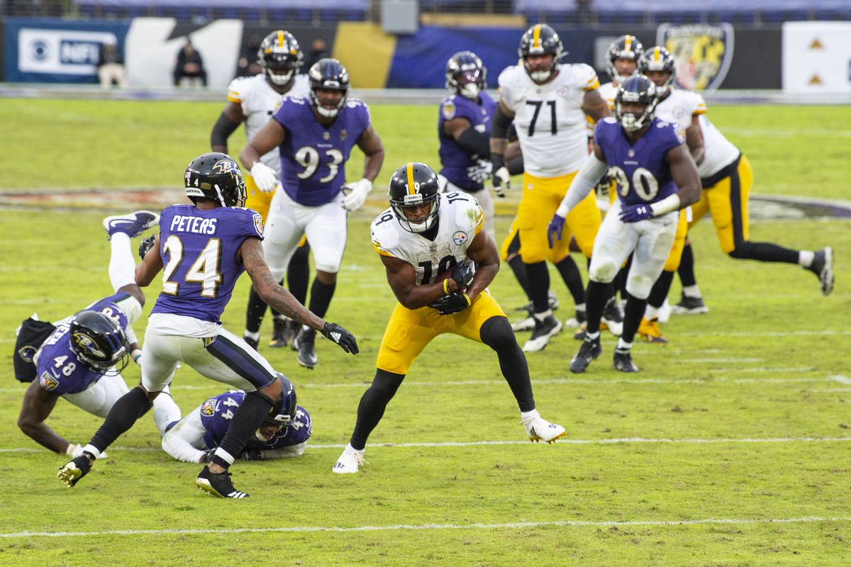 Pittsburgh Steelers wide receiver JuJu Smith-Schuster (19) catches a pass as Baltimore Ravens cornerback Marlon Humphrey (44), inside linebacker Patrick Queen (48) and cornerback Marcus Peters (24) defend during the second half at M&T Bank Stadium.