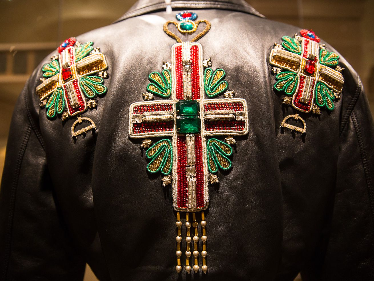 "The back of a jacket on display at the Metropolitan Museum of Art's ""Heavenly Bodies"" exhibit, which closed October 8."