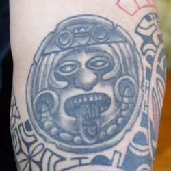 """""""This guy with a huge beard who looked like he was in Z.Z. Topp freehanded this piece, which is the Mayan sun god."""""""