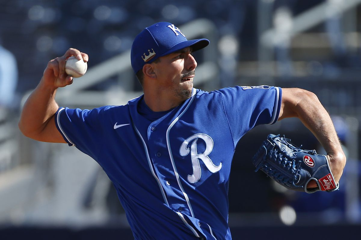 Pitcher Kyle Zimmer #45 of the Kansas City Royals throws against the Seattle Mariners during the eighth inning of the MLB spring training baseball game at Peoria Sports Complex on March 09, 2021 in Peoria, Arizona.