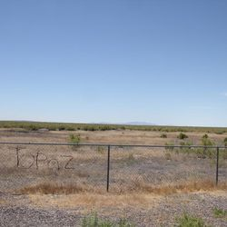 """The word """"Topaz"""" spelled into the fence in barbed wire can be seen at the memorial site just outside of the World War II Japanese-American Topaz Internment Camp."""