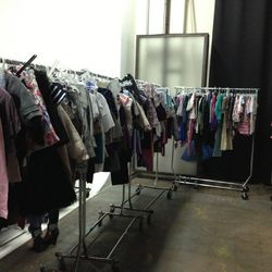The children's clothing rack is located next to the dressing room.