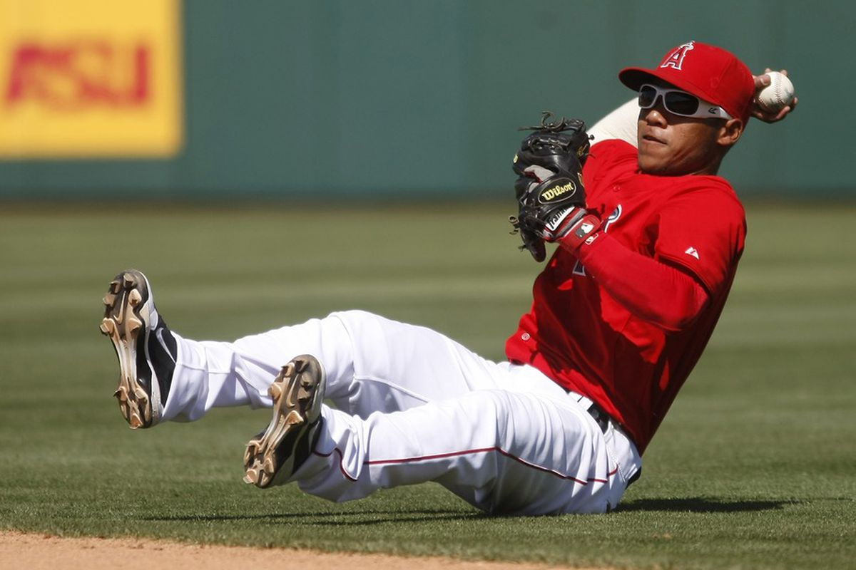 April 1, 2012; Scottsdale, AZ, USA; Los Angeles Angels second baseman Alexi Amarista (19) makes the play for the out against the Chicago Cubs in the fifth inning at Tempe Diablo Stadium.  Mandatory Credit: Rick Scuteri-US PRESSWIRE