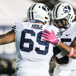 Brigham Young Cougars running back Tyler Allgeier (25) celebrates with Brigham Young Cougars offensive lineman Tristen Hoge (69) after scoring a touchdown during an NCAA football game at LaVell Edwards Stadium in Provo on Saturday, Oct. 31, 2020.