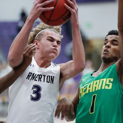 Riverton's Cody Nixon (3) makes a lay-up attempt against Kearns's Fuad Mowlid (1) in a high school boys basketball game at Riverton High School in Riverton on Friday, Dec. 18, 2020.