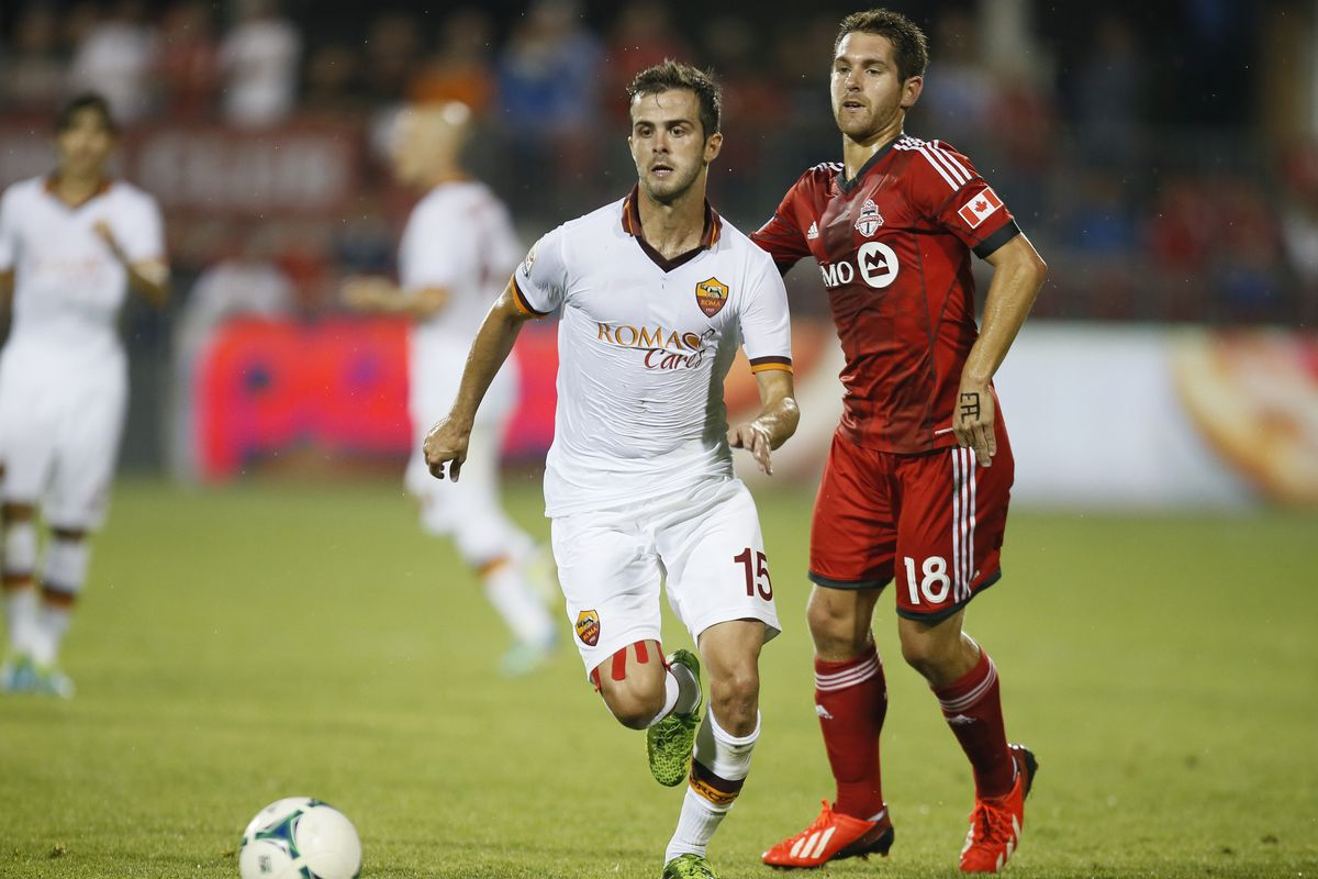 The guy in red plays for TFC. Really. We swear!