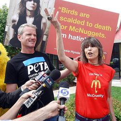 Chrissie Hynde, right, of the group Pretenders stands with PETA Vice President Dan Mathews as they join other PETA supporters at a Salt Lake City McDonald's Monday to protest the company's perceived treatment of chickens.