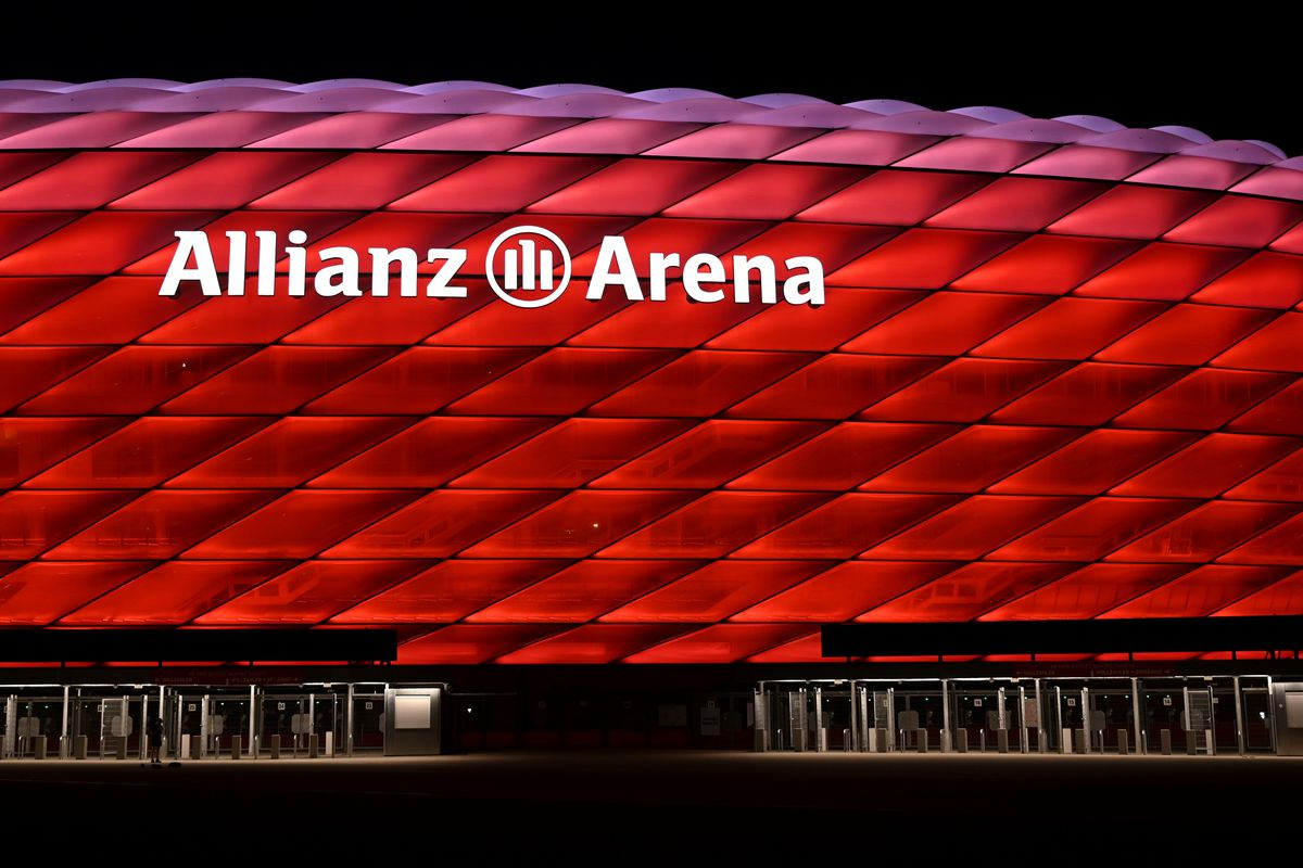 A picture taken on April 17, 2020 shows a view of the Allianz Arena football stadium lighted in red in Munich, southern Germany. - The German first division Bundesliga team FC Bayern Munich plays home matches at the Allianz Arena.