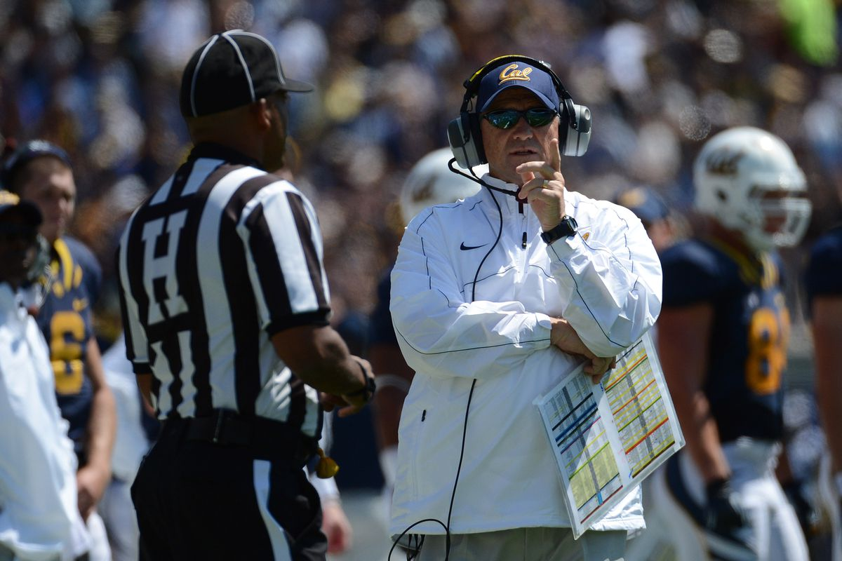 September 1, 2012; Berkeley, CA, USA; California Golden Bears head coach Jeff Tedford points to the scoreboard with a referee during the second quarter against the Nevada Wolf Pack at Memorial Stadium. Mandatory Credit: Kyle Terada-US PRESSWIRE