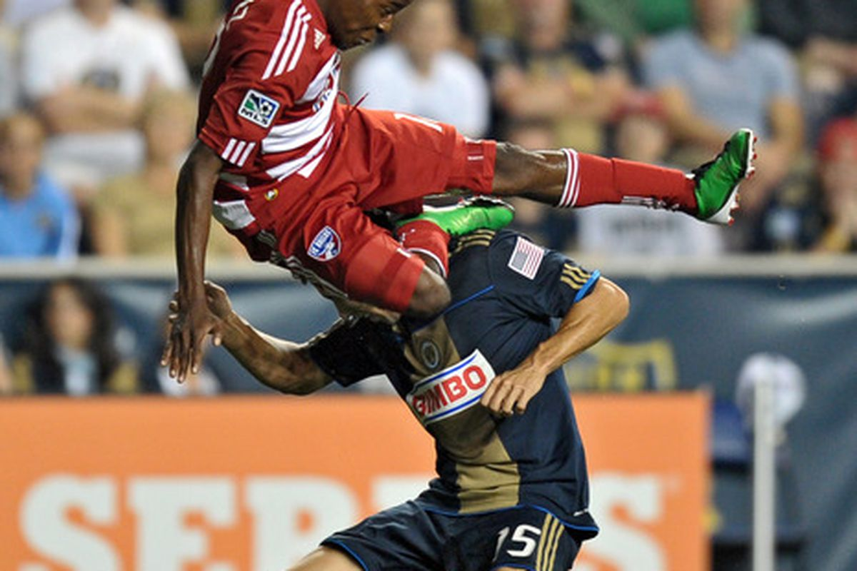 CHESTER, PA- AUGUST 13: Marvin Chavez #18 of the FC Dallas goes over the top of Gabriel Farfan #15 of the Philadelphia Union at PPL Park on August 13, 2011 in Chester, Pennsylvania. (Photo by Drew Hallowell/Getty Images)