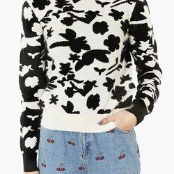 "<a href=""http://shop.nordstrom.com/S/topshop-floral-sweater/3617424?origin=category&contextualcategoryid=0&fashionColor=&resultback=1842"">Topshop Floral Sweater</a>, $96 at Nordstrom"