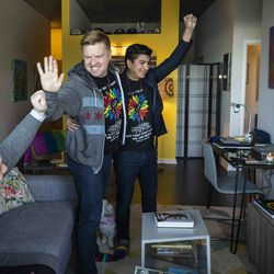 Matt Schreck, 43, his husband, Fernando Gutierrez, 41, and their friend Brian Dowling (left), 39, cheer and high five as they watch the inauguration ceremony for President Joe Biden and Vice President Kamala Harris from Schreck and Gutierrez's South Loop home, Wednesday morning, Jan. 20, 2021.