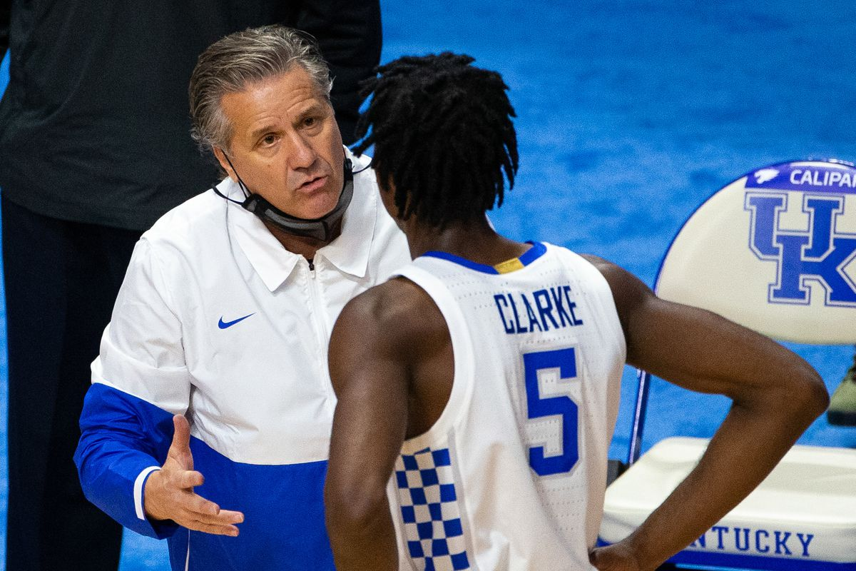 Kentucky Wildcats head coach John Calipari talks with guard Terrence Clarke in the second half against the Richmond Spiders at Rupp Arena at Central Bank Center.