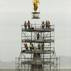 The Angel Moroni statue is removed from the Salt Lake Temple of The Church of Jesus Christ of Latter-day Saints during renovation in Salt Lake City on Monday, May 18, 2020.
