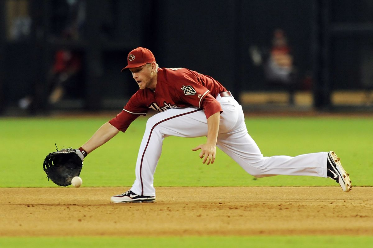 PHOENIX, AZ - JULY 22:  Lyle Overbay #37 of the Arizona Diamondbacks makes a play on a ground ball against the Houston Astros at Chase Field on July 22, 2012 in Phoenix, Arizona.  (Photo by Norm Hall/Getty Images)