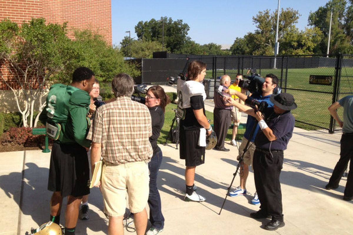 The media wants to know how awesome it feels to wear green and gold.   via @BUFootball