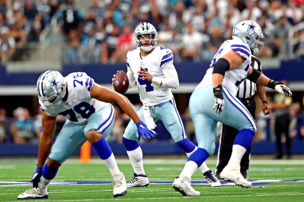 Dallas Cowboys quarterback Dak Prescott (4) throws a pass during the first quarter against the Carolina Panthers at AT&T Stadium.