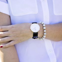 Her watch is Daniel Wellington and her bracelet was a gift from a friend.