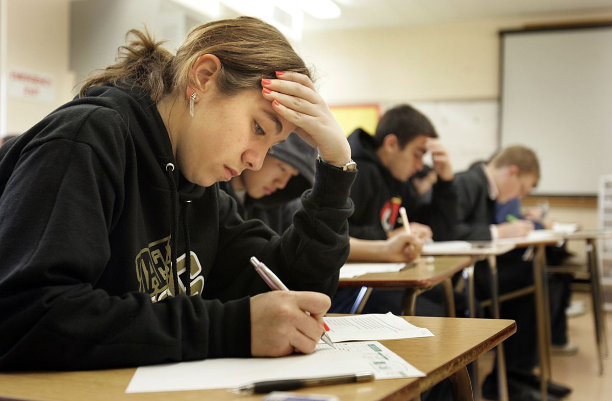 Students sitting at desks taking tests.