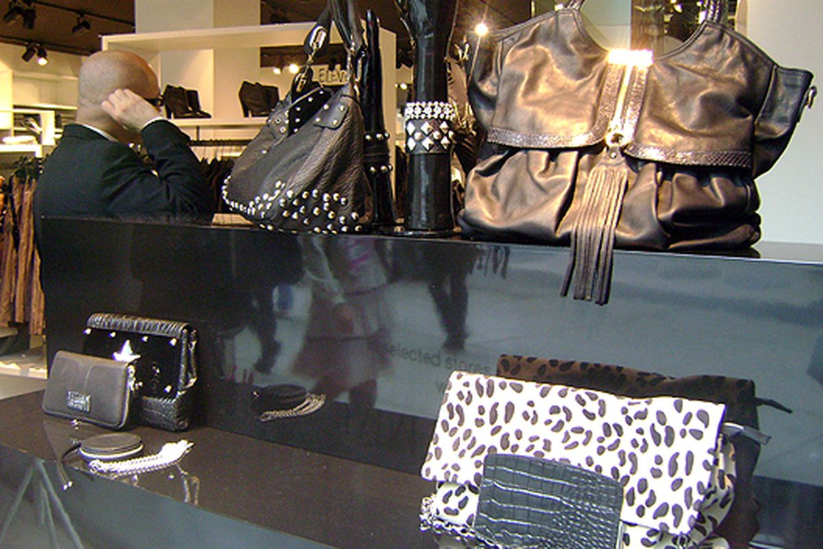 Some of the Choo collab accessories in an H&M window