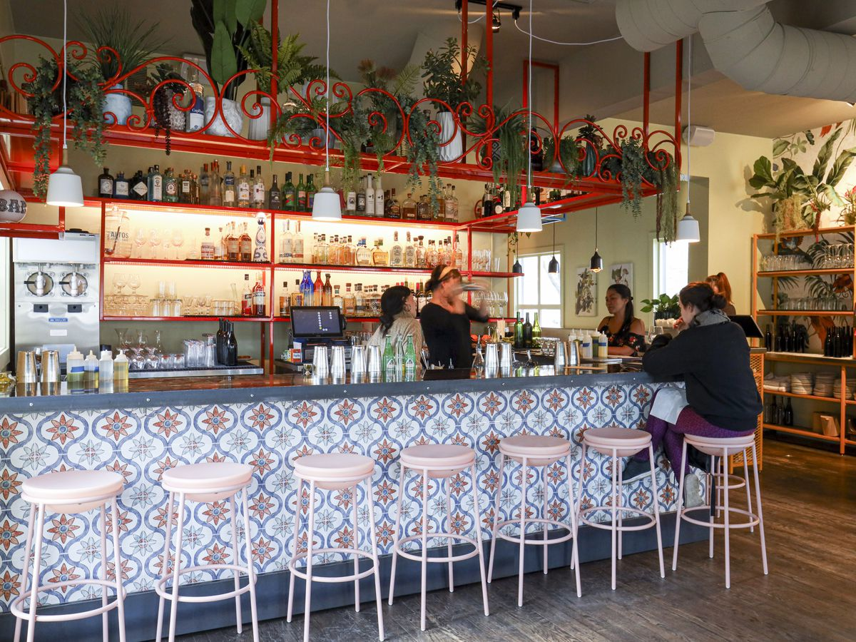 Bar area with colorful tiles and lots of plants