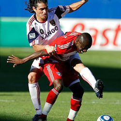 RSL forward Fabian Espindola, top, battles for the ball with FC Dallas defender Jair Benitez in Saturday's game.