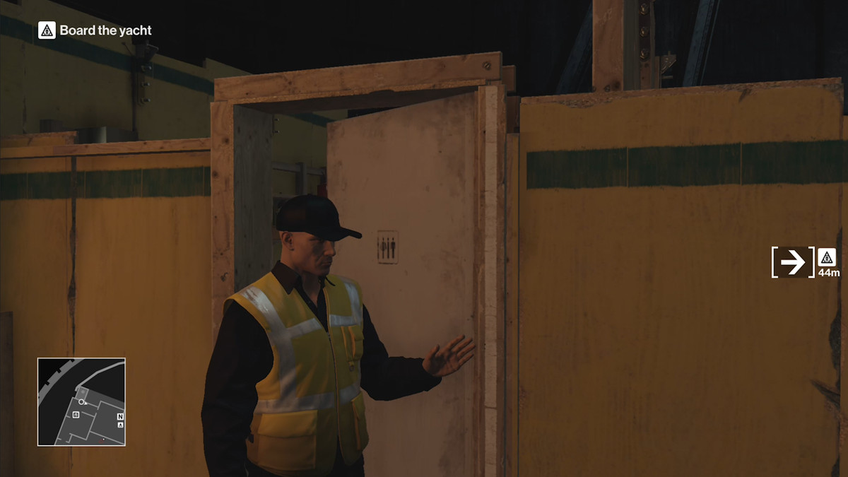 Playable character dressed in a high-visibility safety vest faces away from a door that is slightly ajar.