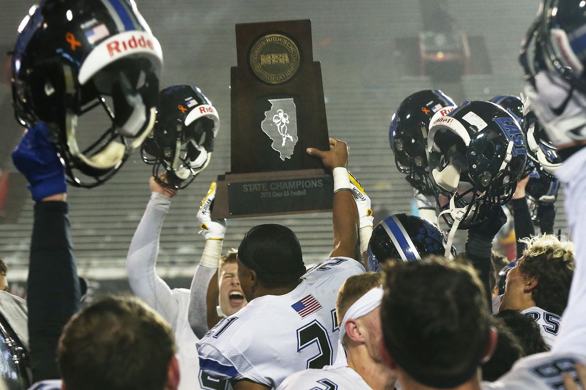Lincoln-Way East's AJ Henning holds the IHSA 8A State Championship trophy after the Griffins defeat Warren 12-0, DeKalb, Illinois, November 30, 2019.