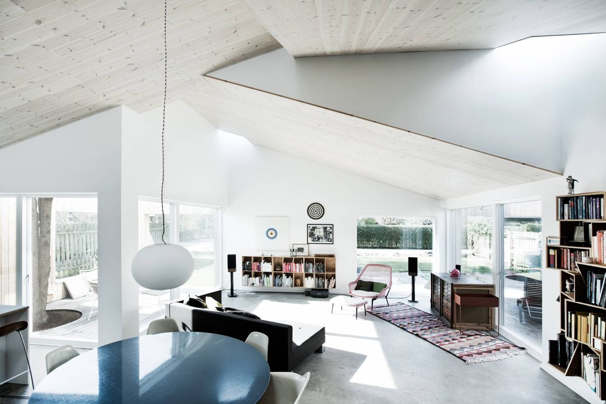 Each shed like roof features a skylight and the perpendicular arrangement of volumes creates interior courtyards acting as light wells bringing the suns