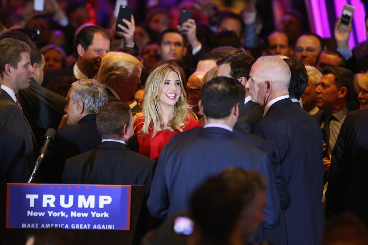 Ivanka Trump surrounded by male Trump supporters