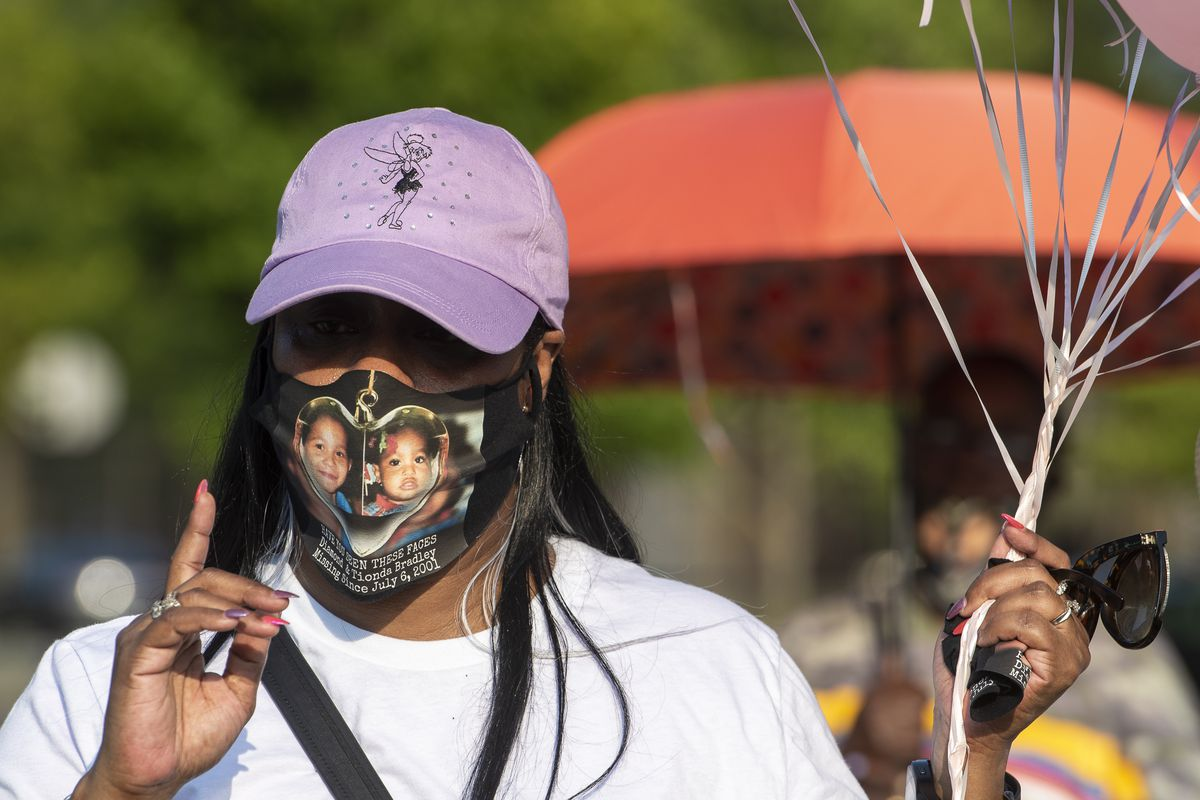 Tracey Bradley, the mother of Diamond and Tionda Bradley, holds balloons during a gathering on July 6, 2020, to commemorate the 19th year that the Bradley family has been looking for Diamond and Tionda.