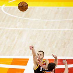 Utah Jazz guard Matt Thomas (21) shoots over Oklahoma City Thunder guard Svi Mykhailiuk (14) during the game at Vivint Smart Home Arena in Salt Lake City on Tuesday, April 13, 2021.