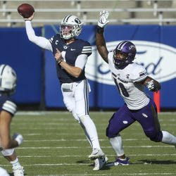 Brigham Young Cougars quarterback Zach Wilson (1) scrambles away from North Alabama Lions defensive end Wallace Cowins Jr. (10) during a game in Provo on Saturday, Nov. 21, 2020.