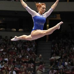 Florida's Bridget Sloan competes on the balance beam during the NCAA college women's gymnastics championships on Saturday, April 19, 2014, in Birmingham, Ala. (AP Photo/Butch Dill)