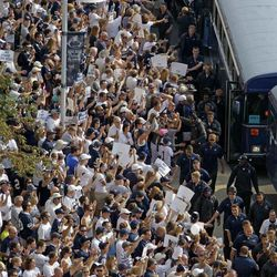 Penn State football fans cheer for the Penn State football team as they arrives by bus at Beaver Stadium for their season opener against Ohio in State College, Pa., Saturday, Sept. 1, 2012.
