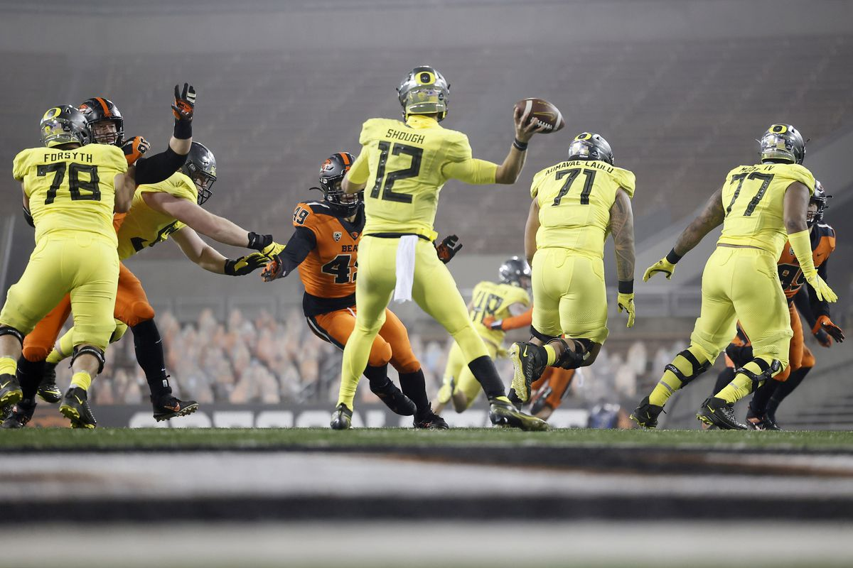 Oregon Ducks quarterback Tyler Shough throws under pressure from Oregon State Beavers linebacker Andrzej Hughes-Murray during the second half at Reser Stadium.