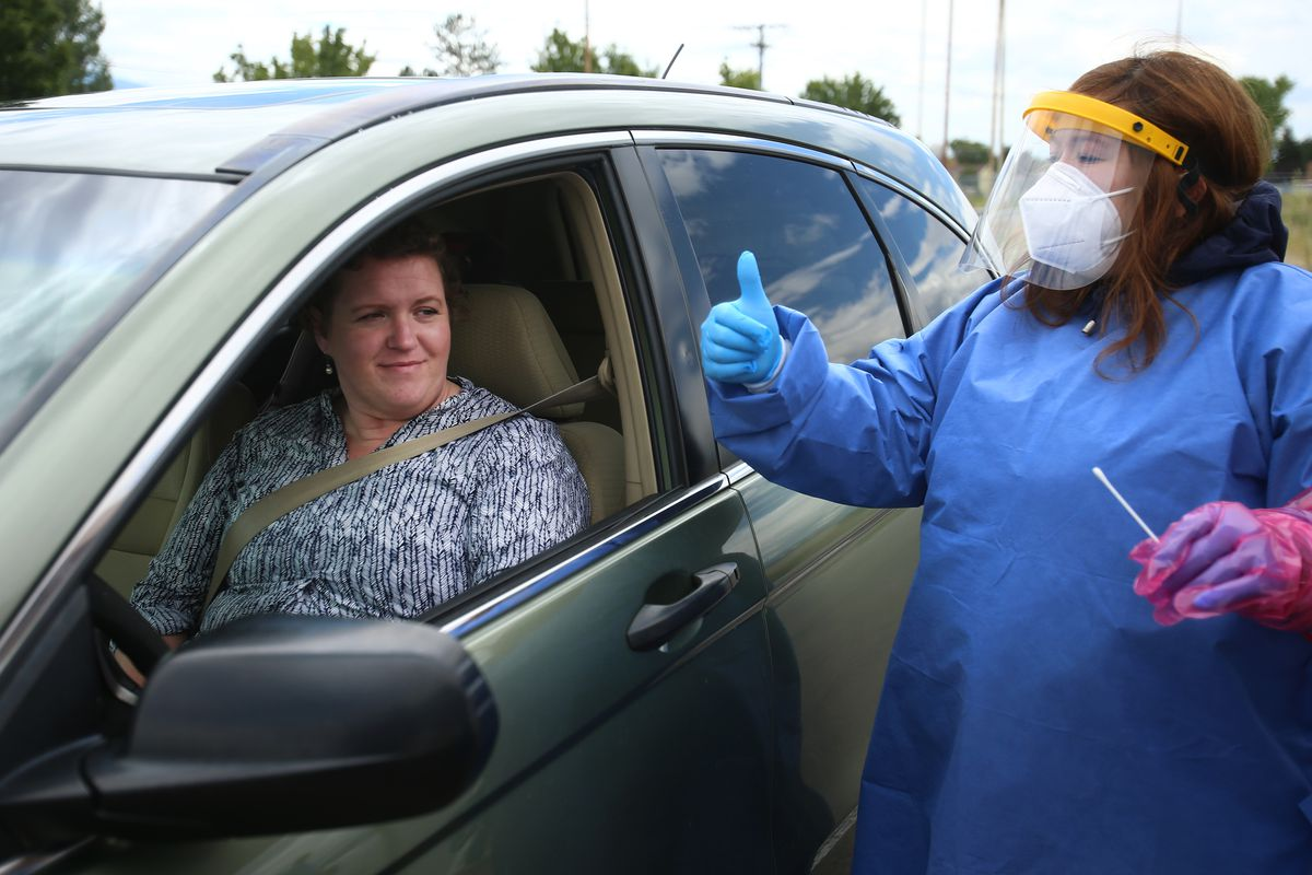 Eve Kovacs, of TestUtah, gives Emily Johnson a thumbs up after Johnson was tested for COVID-19 at a site near the Utah Olympic Oval in Kearns on Tuesday, June 30, 2020.