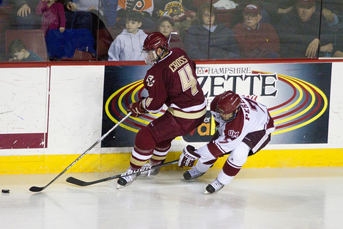"""BC's Tommy Cross battles for the puck with UMass sophomore Michael Pereira (via <a href=""""http://www.flickr.com/photos/brainpa/5483506474/"""">Dennis Pause</a>)"""