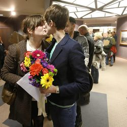 Nicole Christensen and her partner, Natalie Dicou, kiss as they wait to get their marriage license. Hundreds turned out to obtain marriage licenses Friday, Dec. 20, 2013, in the Salt Lake County offices after a federal judge ruled that Amendment 3, Utah's same-sex marriage ban, is unconstitutional.