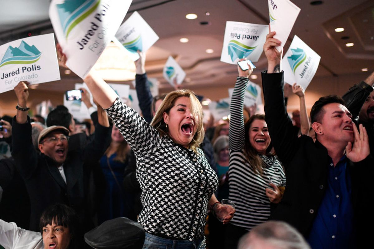Gabriella Martinez (center) cheers for newly elected governor of Colorado Jared Polis during the Democratic party in downtown Denver on Election Night 2018.
