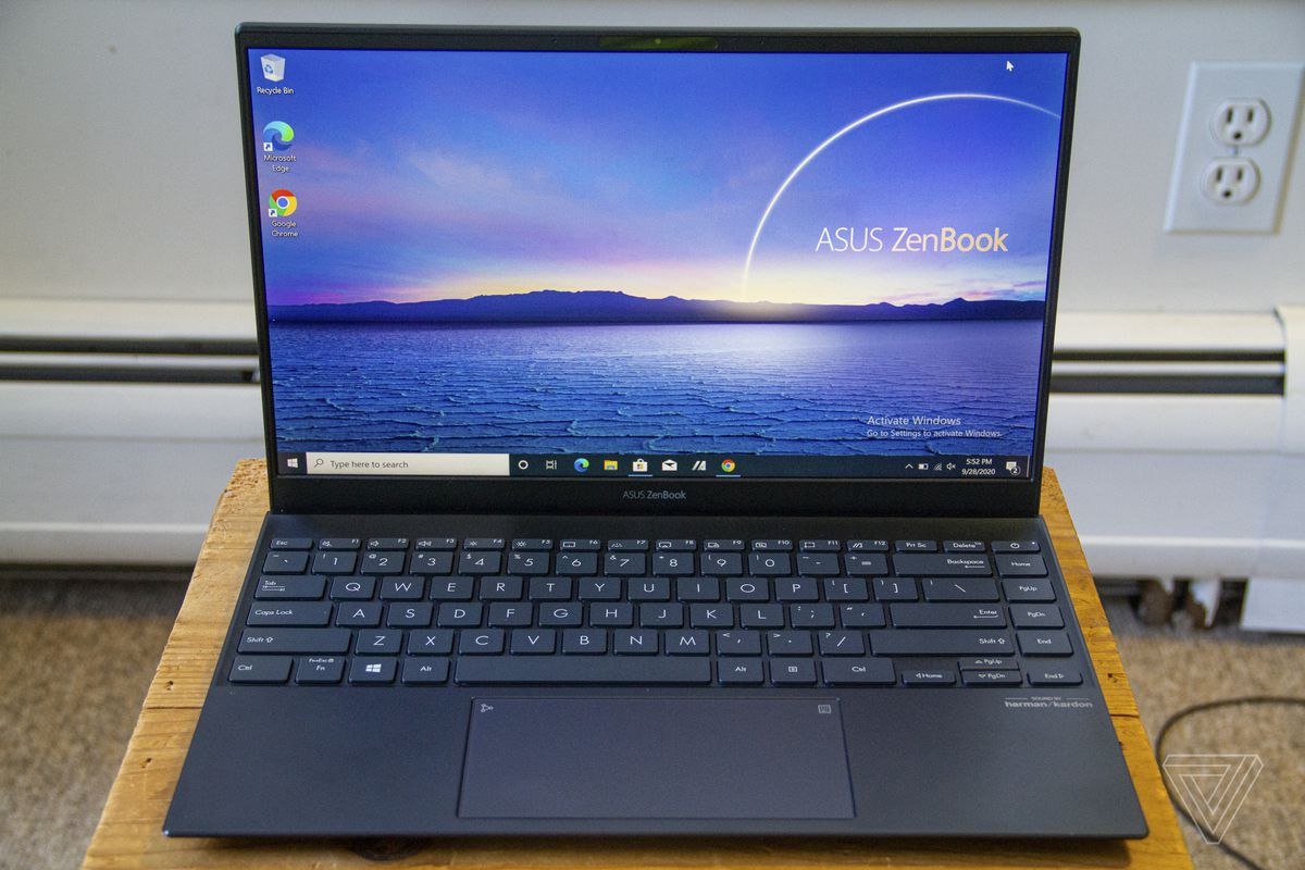 The Asus Zenbook 14 keyboard and screen from above.