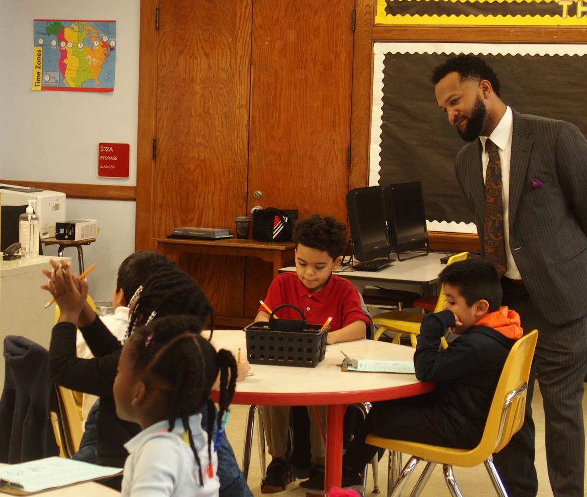 Antonio Burt, the district's chief academic officer, observes a new gifted education CLUE class at Treadwell Elementary.