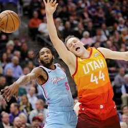 Miami Heat forward Derrick Jones Jr. (5) fouls Utah Jazz forward Bojan Bogdanovic (44) as the Utah Jazz and the Miami Heat play in an NBA basketball game at Vivint Smart Home Arena in Salt Lake City on Wednesday, Feb. 12, 2020.
