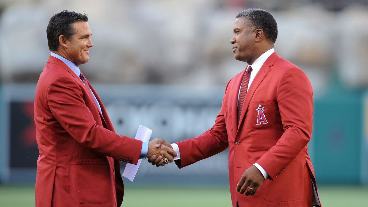 Tim Salmon (left) and Garret Anderson (right) wearing red blazers and shaking hands.
