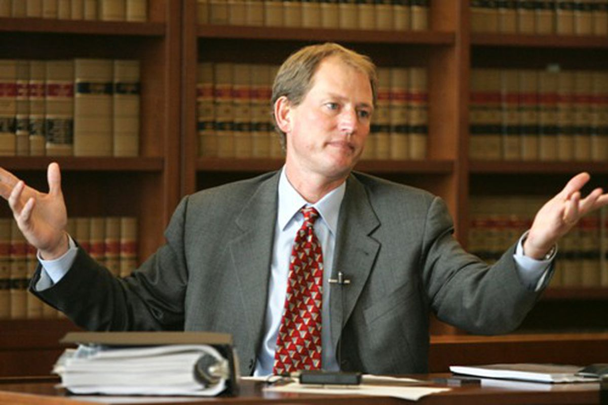 Rick Neuheisel was fired from Washington because he <em>lied </em>about participating in an office pool. (Photo Credit: New York Times)