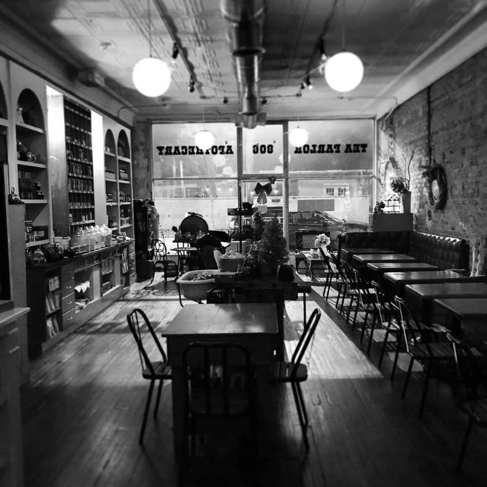 A black and white photo of the interior of Tipple and Rose Tea Parlor on North Highland in Atlanta